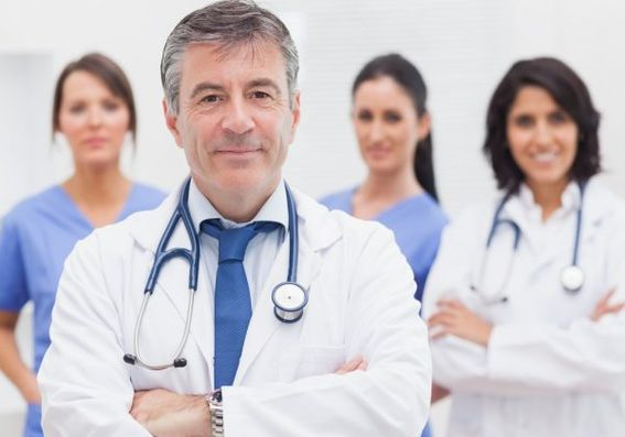 depositphotos_24117303-stock-photo-doctor-and-his-team-smiling.jpg